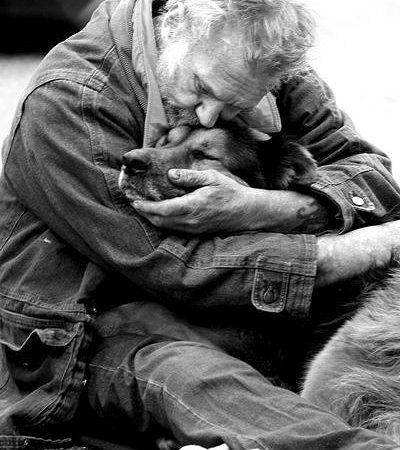 Man Hugging Dog