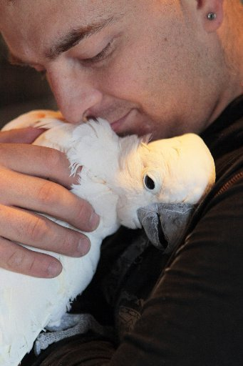 man hugging bird